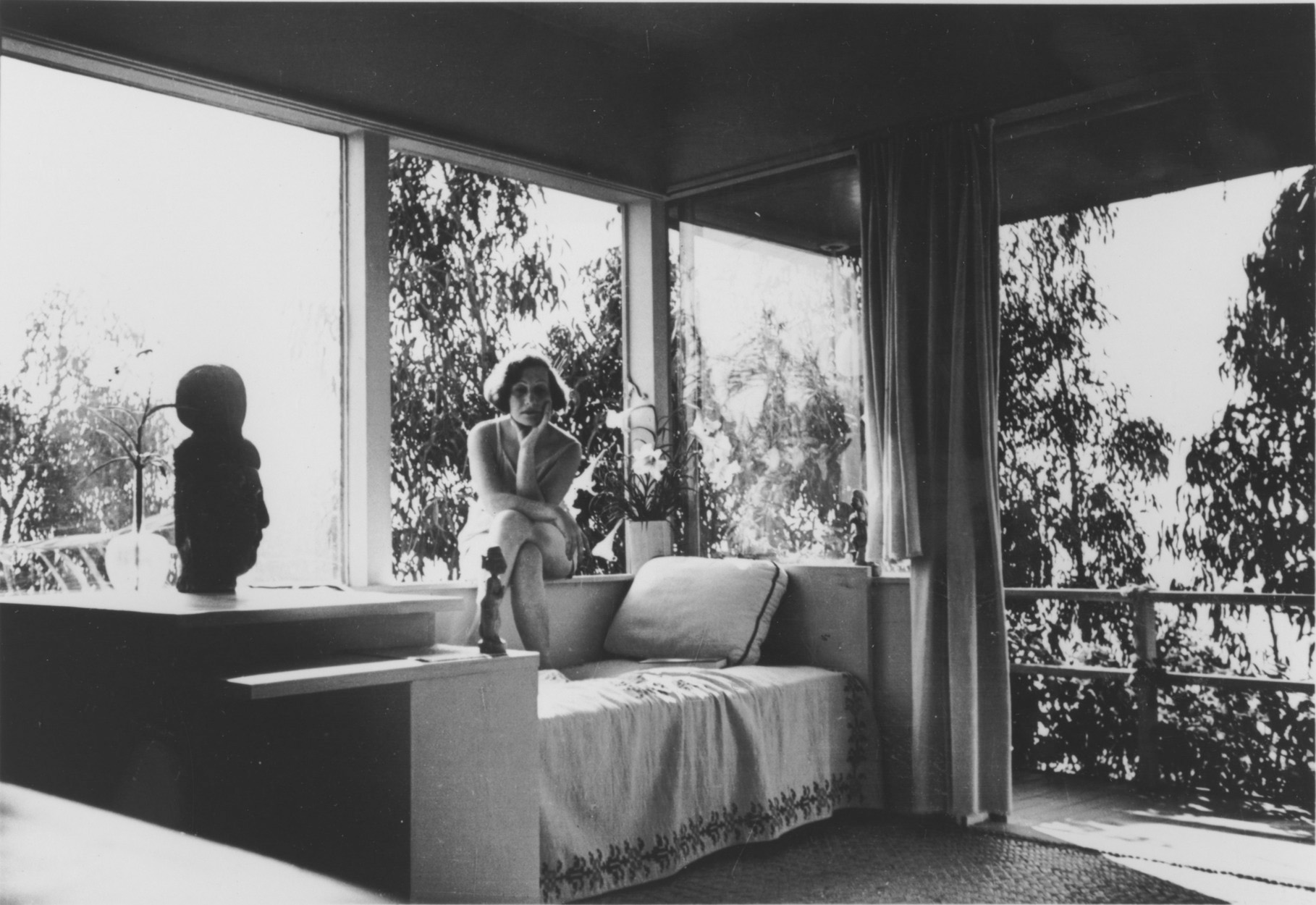 Galka Scheyer in her Hollywood Hills house designed by Richard Neutra. Lette Vaselka, <em>Galka Scheyer in Sunsuit, Seated on Windowsill</em>, ca. 1940-43. Photograph, 3 1/2 x 4 3/4 in. Courtesy of the Blue Four Galka Scheyer Collection Archives, Norton Simon Museum, Pasadena, CA.