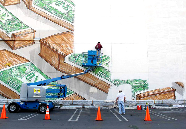 Mural by Italian street artist Blu being painted over by MOCA workers, December 2010. Photo: Casey Caplowe.