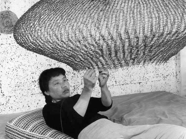 Ruth Asawa at work, 1957. Photograph by Imogen Cunningham. © 1957, 2014 Imogen Cunningham Trust.