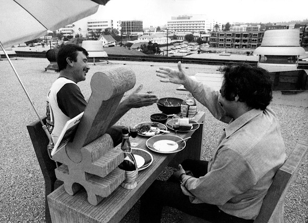 Billy Al Bengston (left) and Frank Gehry (right) on the rooftop of Gehry's office in Santa Monica, ca. 1970. Photographer unknown. Image courtesy of and © Billy Al Bengston.