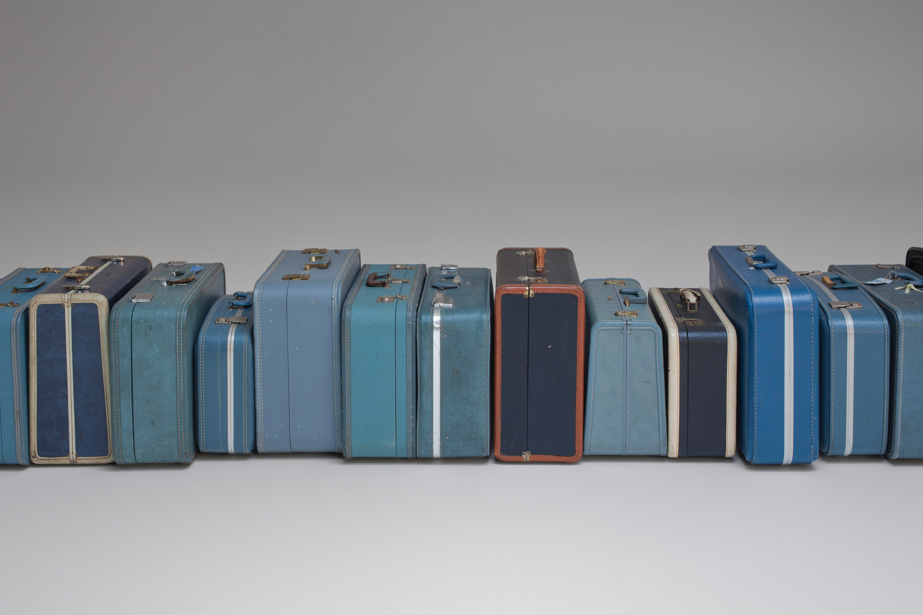 Zoe Leonard <i>1961</i>, 2002 - ongoing. Blue suitcases, Dimensions variable. Courtesy of the artist and Galerie Gisela Capitain, Cologne, Germany. Photo by Bill Jacobson.