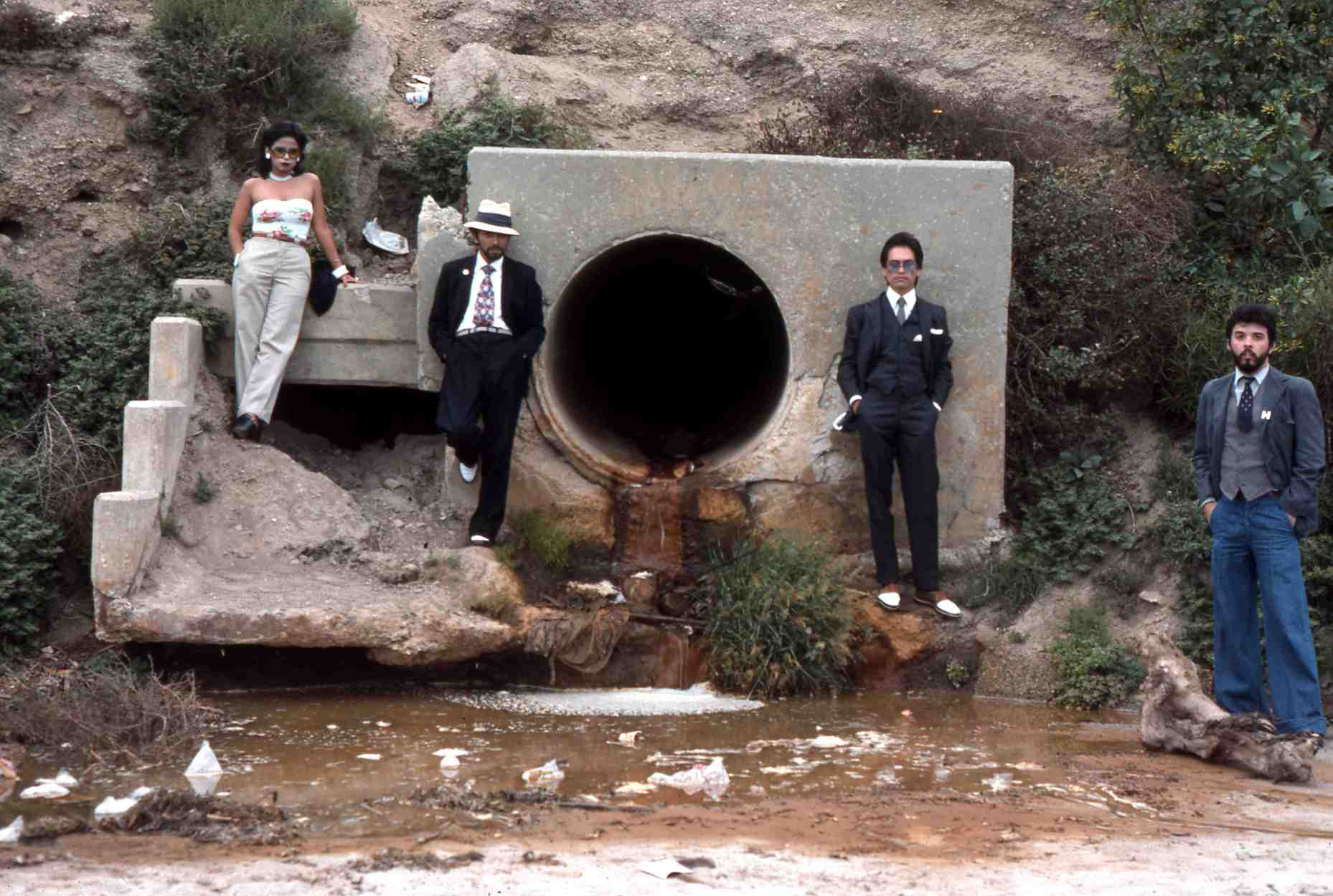 Asco, <em>Asshole Mural</em>, 1974. Colour photograph. Photograph: Harry Gamboa, Jr, showing Patssi Valdez, Humberto Sandoval, Willie Herrón III and Gronk.