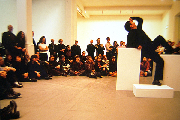 "Bruce McLean, <em>Pose Work for Plinths</em>, 1970/2002. Performance in ""A Short History of Performance,"" at Whitechapel Art Gallery, April 20, 2002. Courtesy of Whitechapel Art Gallery, London."
