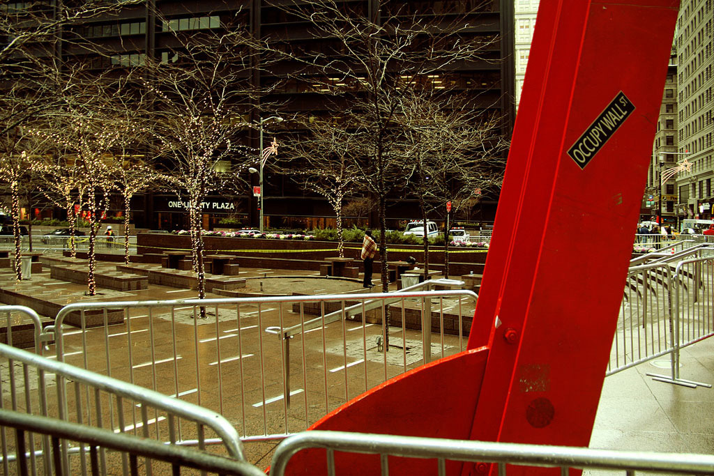 Mark di Suvero's <i>Joie de Vivre</i> in an empty Zuccotti Park, after the eviction of the Occupy Wall Street protesters, December 2011. Photo: Trevor Patt.