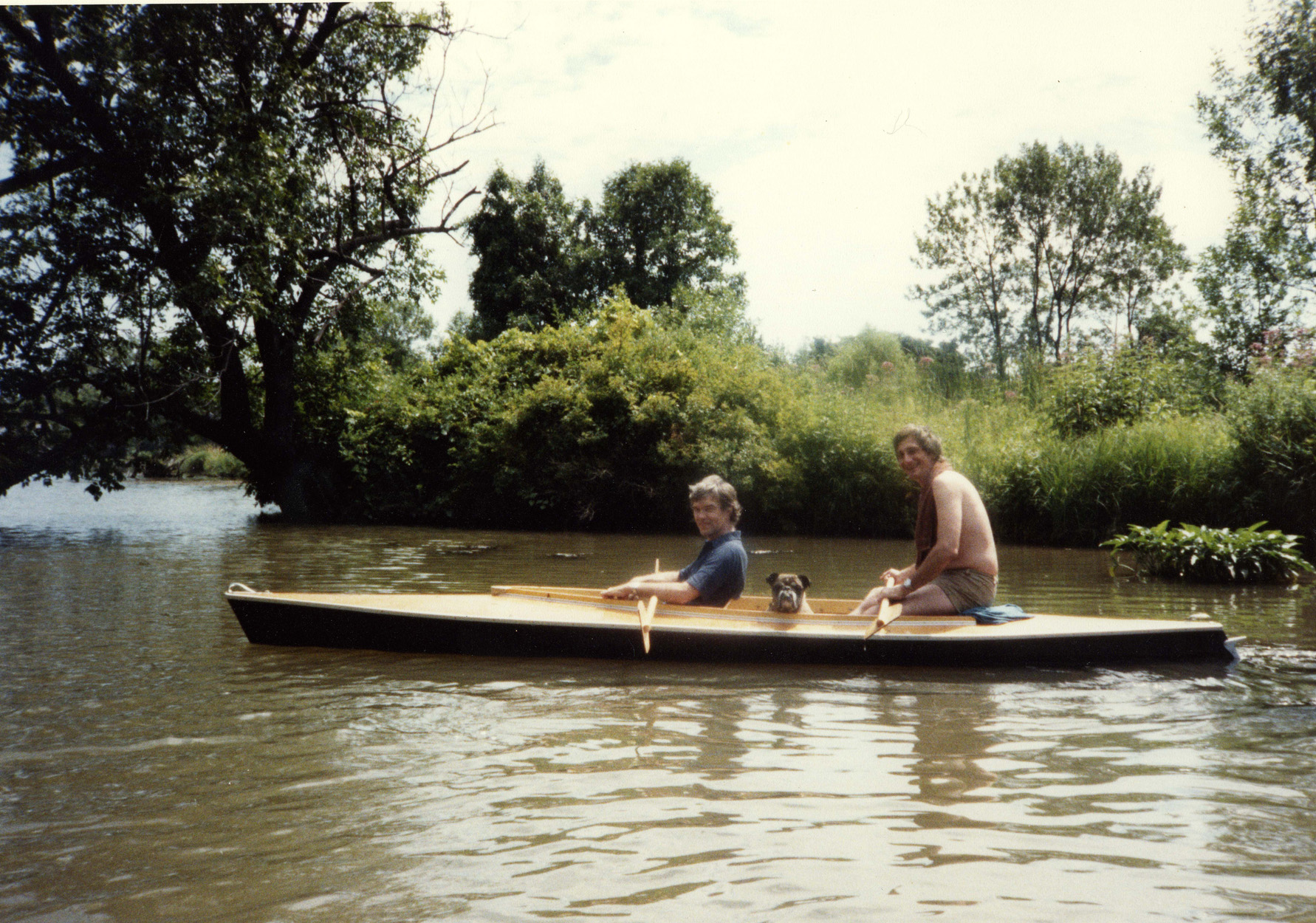 Roger Brown (left) and George Veronda with their dog, Babe, in New Buffalo, Michigan, c. 1982. Photographer unknown.