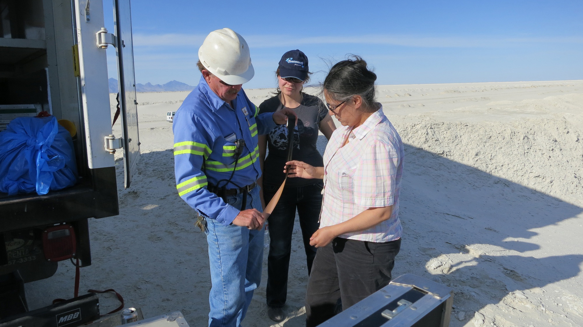 Tacita Dean on location for <em>JG</em> at Intrepid Potash, Wendover, Utah, with Ponds Supervisor, Russ Draper, and his daughter, Jessica (May 2012). Photo: Richard Torchia.