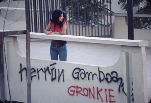 Asco, <em>Spray Paint LACMA</em>, 1972. Colour photograph. Photograph: Harry Gamboa, Jr, showing Patssi Valdez.