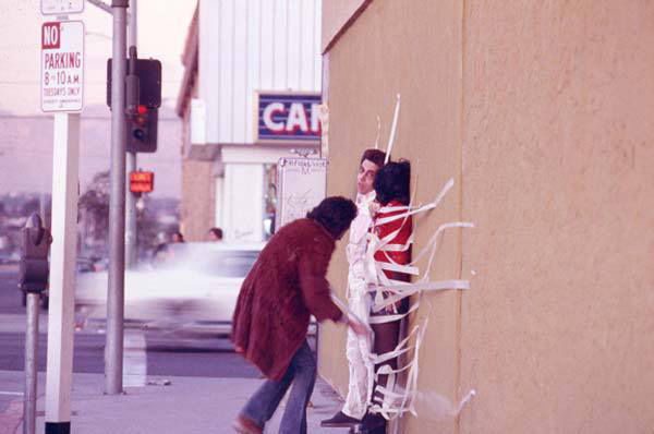 Asco, <em>Instant Mural</em>, 1972. Performance. Pictured: Gronk, Patssi Valdez, and Humberto Sandoval. Photo: Harry Gamboa, Jr. Courtesy the artists.