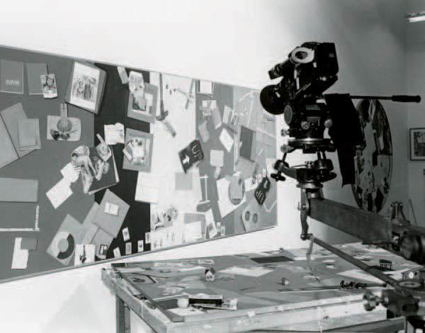 Production still from <i>Routine Pleasures</i>, featuring Farber's painting in the background. Copyright Babette Mangolte, all rights of reproduction reserved.