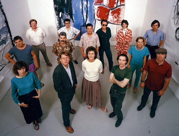 Rosamund Felsen Gallery, 1986. Back (L-R): Leland Rice, Lari Pittman, James Hayward, Karen Carson, Grant Mudford. Middle: Chris Burden, Steve Rogers, Richard Jackson, Alexis Smith. Front: Renée Petropoulos, Jeffrey Vallance, Rosamund Felsen, Mike Kelley, Paul McCarthy. Paintings by Paul McCarthy. Photo: Jim McHugh. Courtesy of the Rosamund Felsen Gallery.