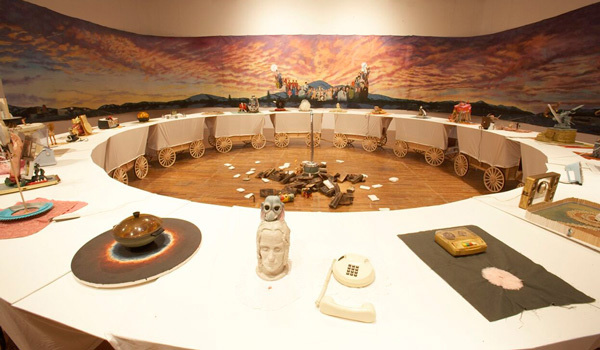 Left: Jim Shaw, <em>The Donner Party</em>, 2003. Mixed media. Installation View at P.S.1, 2007. Photo by Matthew Septimus. Courtesy P.S.1 Contemporary Art Center.