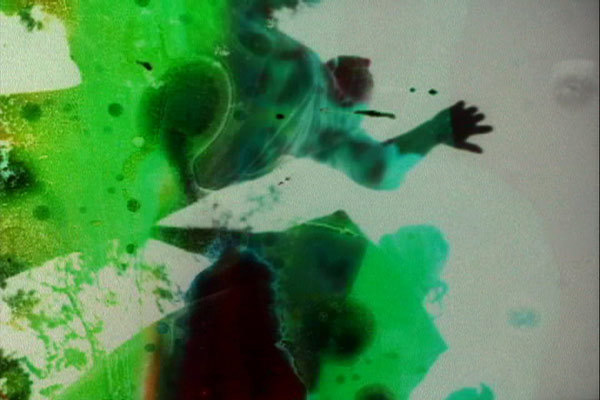 Jennifer West, <em>Nirvana Alchemy Film, (16 mm black & white film soaked in lithium mineral hot springs, pennyroyal tea, doused in mud, sopped in bleach, cherry antacid and laxatives - jumping by Finn West & Jwest)</em>, 2007. 2 min, 51 sec.