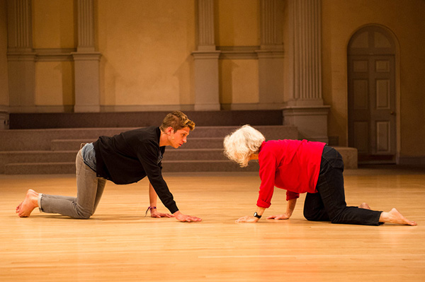Brennan Gerard (left) performing with Simone Forti in <em>That Fish is Broke</em> at Danspace Project, St. Mark's Church, New York, NY, 2012. Photo: Ian Douglas.