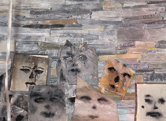 "Samara Golden, <em>Bad Brains</em>, 2012. Rmax foam insulation, paint, glue. Detail of handmade faux rock wall and ""Suicide Masks,"" Frieze Art Fair, New York. Courtesy Night Gallery."