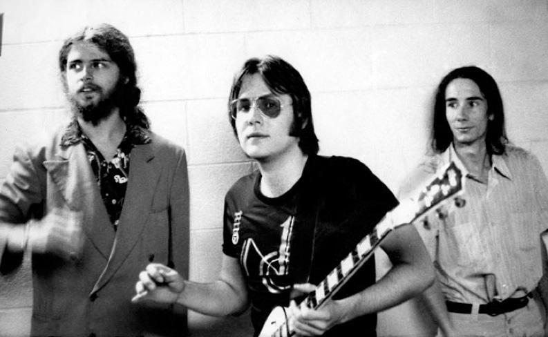 L to R: Jim Shaw, Ron Asheton, and Mike Kelley at Second Chances in Ann Arbor, 1975. Photo: Cary Loren.