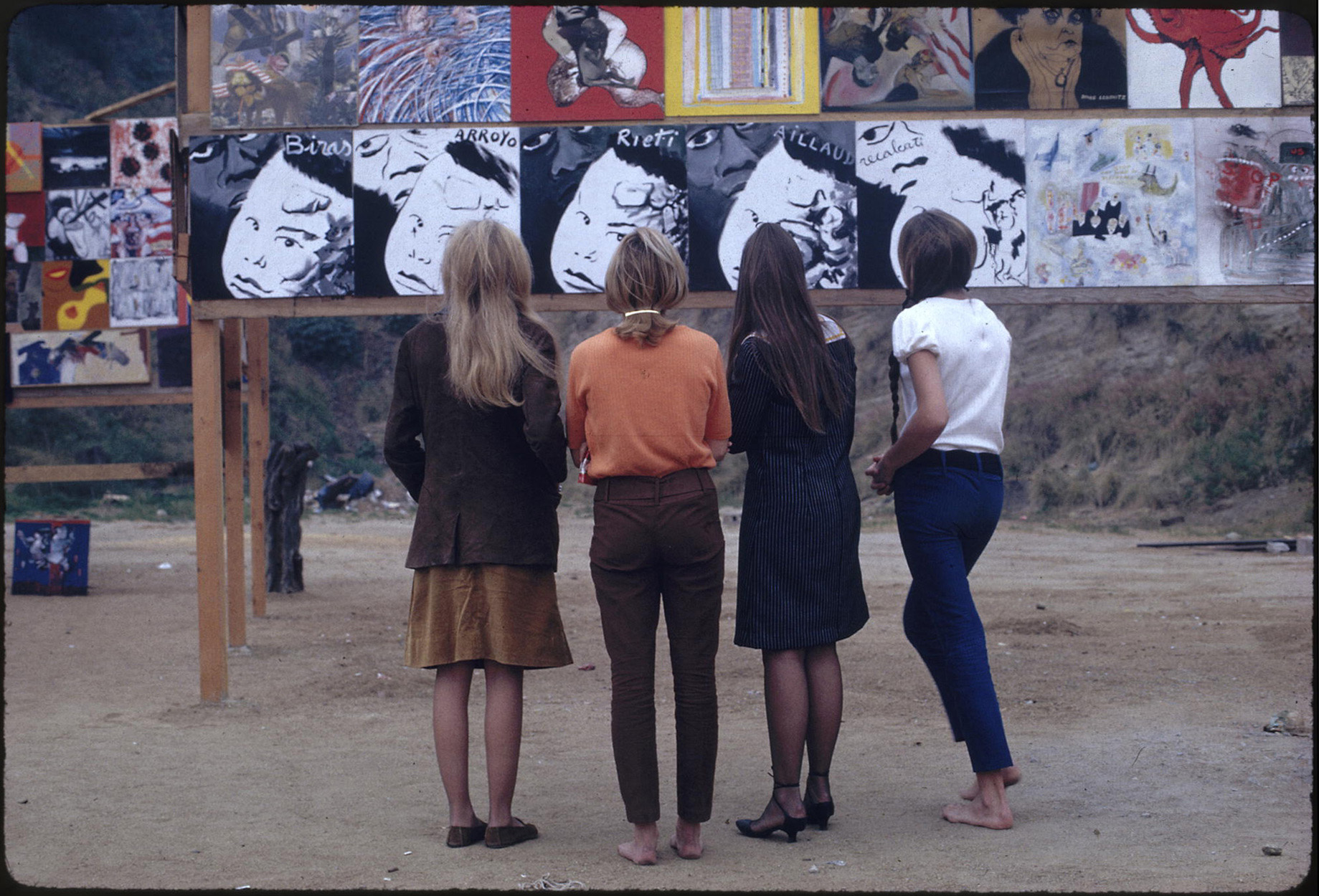 Four women looking at art work at the <i>The Artists' Tower of Protest</i>, 1966. Charles Brittin Archive, The Getty Research Institute, Los Angeles, (2005.M.11). Photo: Charles Brittin. © J. Paul Getty Trust.