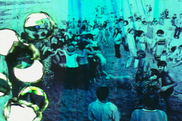 "Jennifer West, <em>Topanga Beach Houses Imminent Domain Rewind Film (16mm film print rubbed with aloe vera gel, smeared with Sex Wax surfboard wax, butter, grass, hole punched - still photos of the Topanga Beach community in the 1960's and 70's before the houses were bulldozed and burned with the Imminent Domain Law - movie stills from ""Muscle Beach"" and ""Cosmic Children"" - found photographs from the Int'l Surfing Magazine (Jim Fitzpatrick), Malibu Times (Gary Graham), Marlies Armand, Jeff Ort, Woody Stuart and John Clemmens)</em>, 2010. 2 min, 47 sec."
